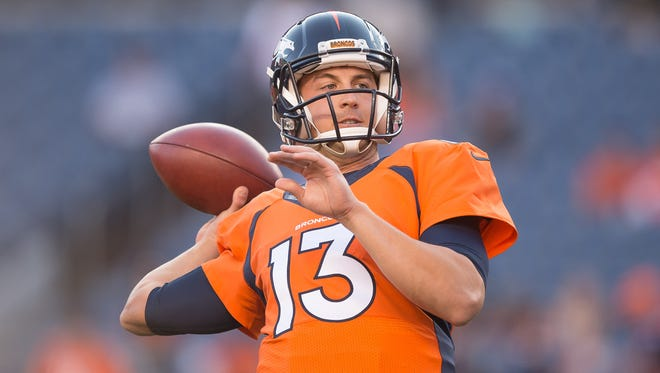 Quarterback Trevor Siemian of the Denver Broncos throws warms up before a preseason game at Sports Authority Field at Mile High in Denver.