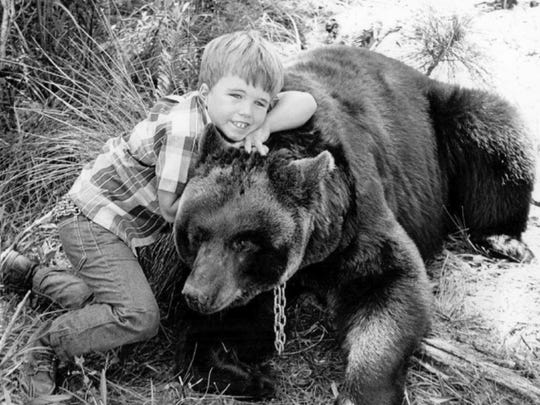 "Scenes from ""Gentle Ben"" were filmed in Port Salerno in 1966. Here, a young Clint Howard poses with ""Ben."""