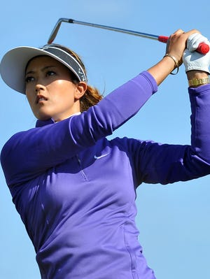 US golfer Michelle Wie watches her tee shot on the 12th hole at the Royal Birkdale golf course in Southport, north-west England, on July 10, 2014, during the first day of the Women's British Open.