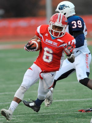 Delaware State's Brycen Alleyne picks up yardage in last year's season-ending win over Howard.