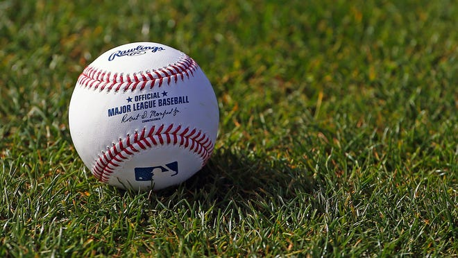 FILE - In this Feb. 17, 2017, file photo, a baseball is shown on the grass at the Cincinnati Reds baseball spring training facility in Goodyear, Ariz. Major League Baseball rejected the players' offer for a 114-game regular season in the pandemic-delayed season with no additional salary cuts and told the union it did not plan to make a counterproposal, a person familiar with the negotiations told The Associated Press. The person spoke on condition of anonymity Wednesday, June 3, 2020, because no statements were authorized.