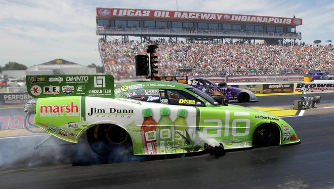 Funny Car drivers John Hale,left, and Jack Beckman race during the Chevrolet Performance NHRA U.S. Nationals Sunday, September 4, 2016, afternoon at Lucas Oil Raceway in Brownsburg.