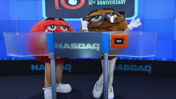 M&M characters ring the closing bell at the Nasdaq MarketSite on Sept. 23 in New York.
