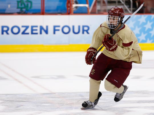 Boston College's Johnny Gaudreau skates down the ice during team practice for the NCAA men's college hockey Frozen Four tournament Wednesday, April 9, 2014, in Philadelphia.