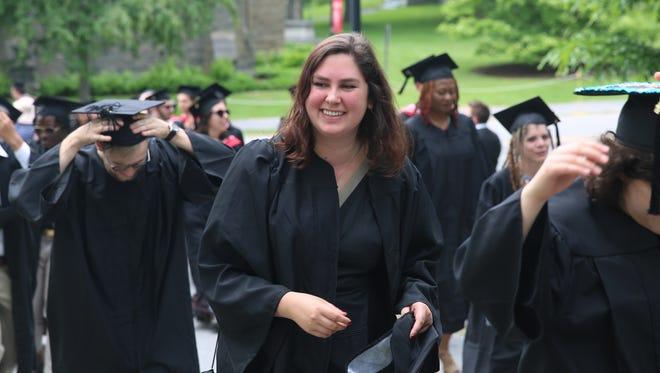 Graduating Bard College student Sabrina Kissack smiles as she walks through campus Saturday.