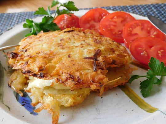 A potato latke grilled cheese and apple panini is a tasty treat to enjoy during Hanukkah.