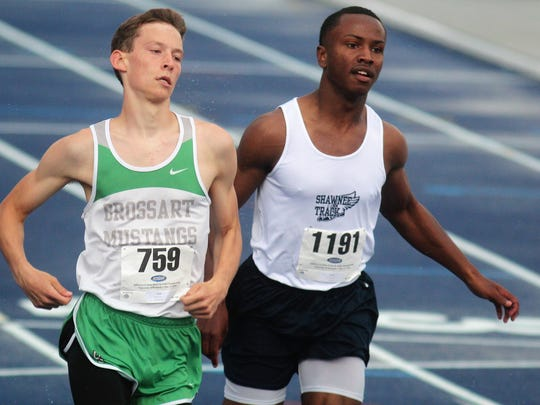 Brossart junior Jordan Moore, left, runs the 100 during the KHSAA Class 1A state track and field meet May 17, 2018 at the University of Kentucky.