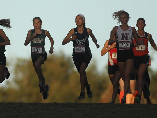 Lincoln freshman Alyson Churchill, third from left, takes off at the start of the FSU Invitational girls elite race at Apalachee Regional Park. Churchill won in 18:06, beating out Melbourne Central Catholic senior Amanda Beach, second from left.