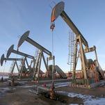 Wells extract oil on public land near Vernal, Utah.