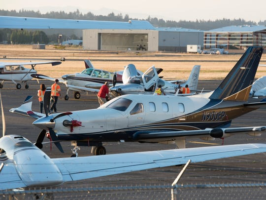 Small planes begin to arrive on Monday, Aug. 21, 2017 at the Salem Airport, prior to the total solar eclipse. Airport staff are expecting more than a 100 planes to arrive in time for the eclipse.