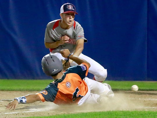 Flat Bill's Gabe Valdez slides into home ahead of the throw to the Fuel's Dominic Hines during a game on Wednesday at Ricketts Park.