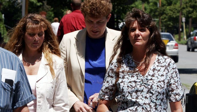 Terry King's daughters, Lori Hibbard, right, and Karen Worcester, left, head to court on June 20, 2005, in Burlington, for the trial of Donald Fell.