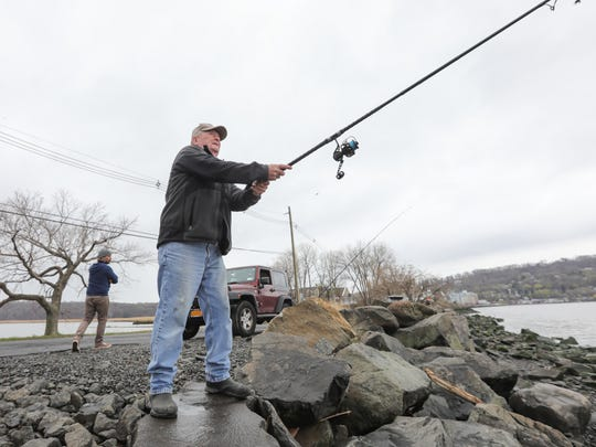 George Phelan from Pearl River casts his line into