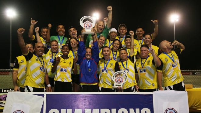 The NAPA Rovers Masters team hoist the 2017 champions trophy of the Red Dragon Sports Co-Ed Masters Soccer League after winning the league's final match against United Masters 5-1 Friday evening at the Guam Football Association National Training Center. The players also received gold medals as top finishers in the league.