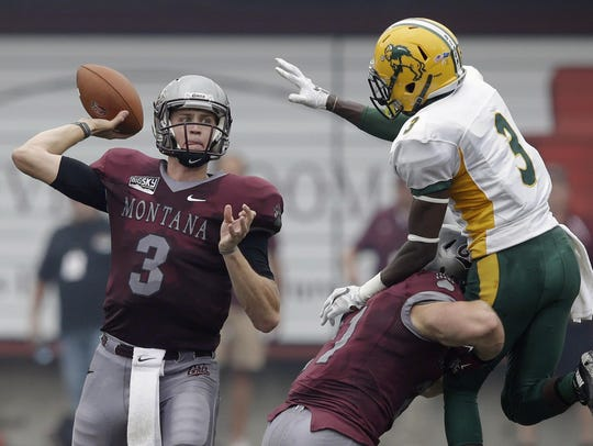Montana's quarterback Brady Gustafson (3) passes the