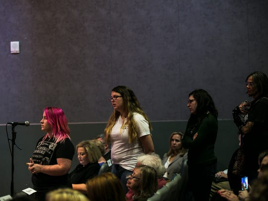 Freshman Elizabeth Clifford, 18, waits in front of a microphone to ask a question of M. David Rudd, president of the University of Memphis, during a two-hour public forum on sexual assault Wednesday. The school held the event to give students, faculty and staff a chance to openly discuss sexual assaults after recent alleged off-campus rapes.
