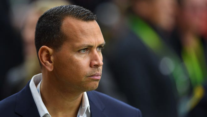 Alex Rodriguez looks on from the sidelines before Super Bowl LI between the Atlanta Falcons and the New England Patriots at NRG Stadium.