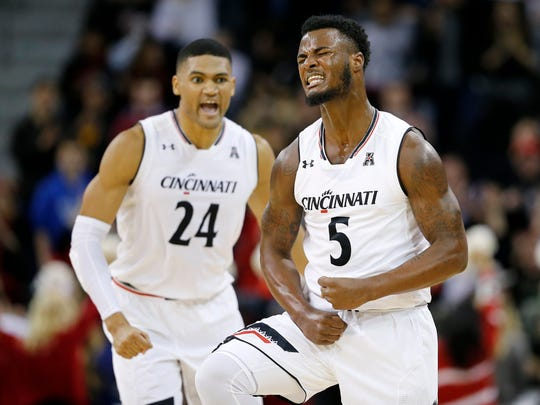 Cincinnati Bearcats guard Trevor Moore (5) celebrates after sinking a three-point basket in the final second of the first half of the NCAA basketball game between the Cincinnati Bearcats and the Cleveland State Vikings at BB&T Arena in Highland Heights, Ky., on Thursday, Dec. 21, 2017. The Bearcats led 43-34 at the half.