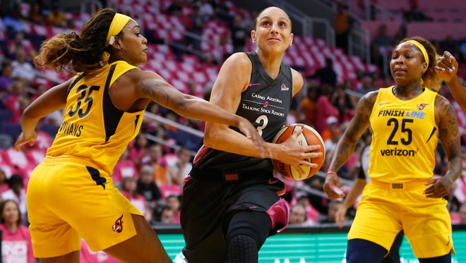 Indiana Fever guard Victoria Vivians (35) guards Phoenix Mercury guard Diana Taurasi (3) during a WNBA game at Talking Stick Resort Arena in Phoenix on August 10, 2018