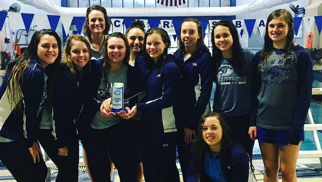 The Piedra Vista girls swim team poses with its first-place trophy after winning the Carlsbad Invitational on Saturday.
