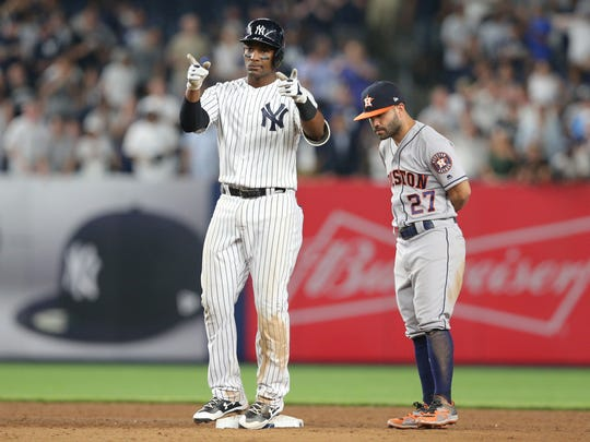 New York Yankees third baseman Miguel Andujar reacts after hitting a double against the Houston Astros during the tenth inning at Yankee Stadium.
