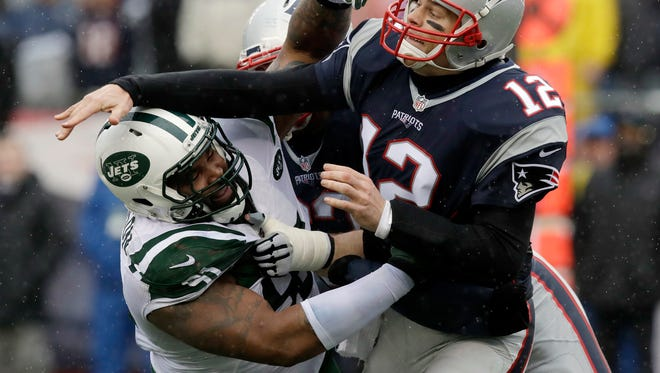 Sheldon Richardson, left, hits New England Patriots quarterback Tom Brady in a December game in  Foxborough, Mass. The Seahawks on Friday acquired Richardson from the Jets in exchange for wide receiver Jermaine Kearse and a second-round draft pick.