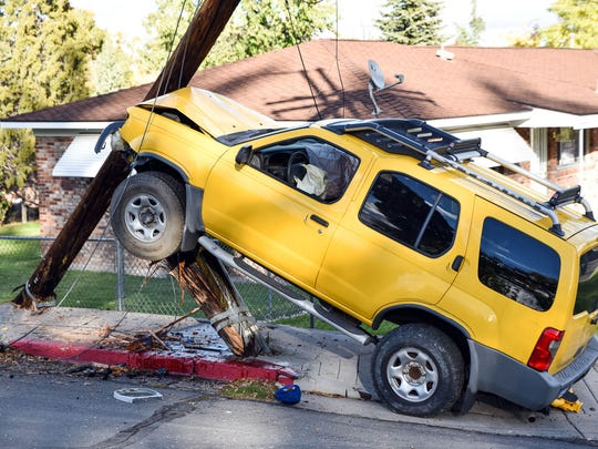 A driver of a yellow SUV drove into a power pole on Arlington Avenue and Shangri-La Drive the afternoon of Nov. 1, 2016. Police report that he was distracted. He declined to give his name.