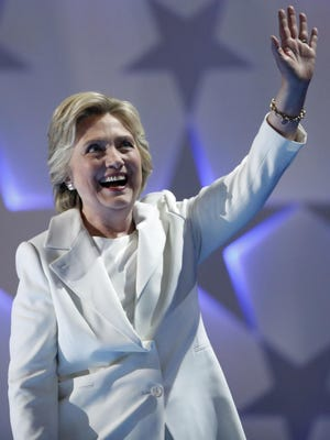 Democratic presidential nominee Hillary Clinton waves as she takes the stage during the final day of the Democratic National Convention in Philadelphia , Thursday, July 28, 2016.