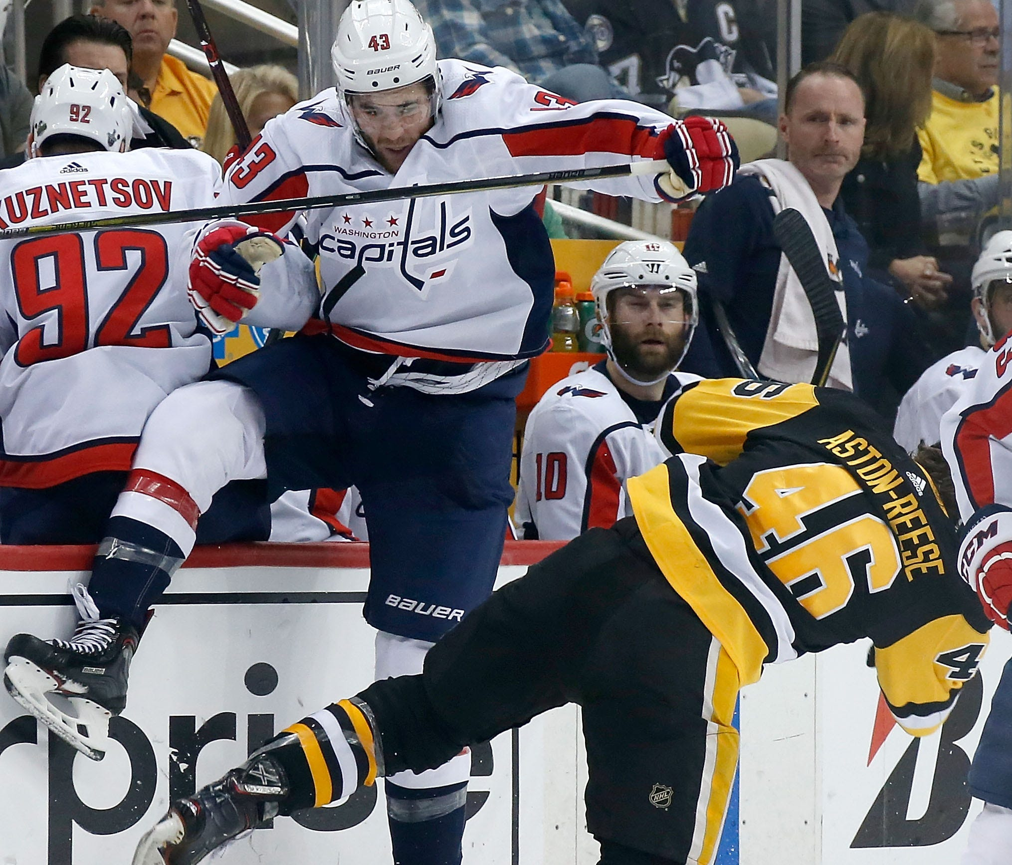 Capitals forward Tom Wilson delivers a huge hit against Pittsburgh's Zach Aston-Reese.