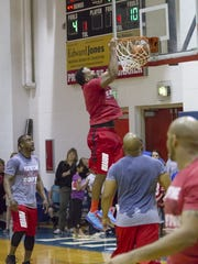 Jay Richardson dunks during a charity game featuring