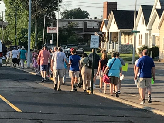 Volunteers walk through Jimtown to see gerrymandering up close during Gerrymander Meander, an event put on by the League of Women Voters.