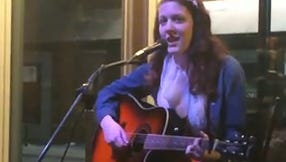 Carly Tebo performs at New Moon Open Mic
