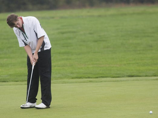 Central York's Joe Parrini putts. Golfers compete in