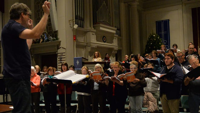 "Sean Hackett, director of the Lebanon County Choral Society, directs a rehearsal for the society's holiday concert ""Handel's Messiah"" at Friedens Lutheran Church, Myerstown on November 30, 2015."