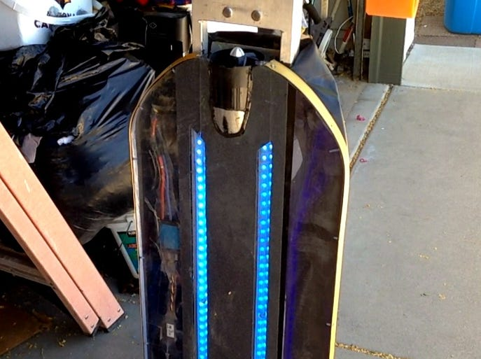 The HoverSkater, a hoverboard being developed by Ahwatukee inventor Jim Pitts, has 18-feet of color changing LED lights.