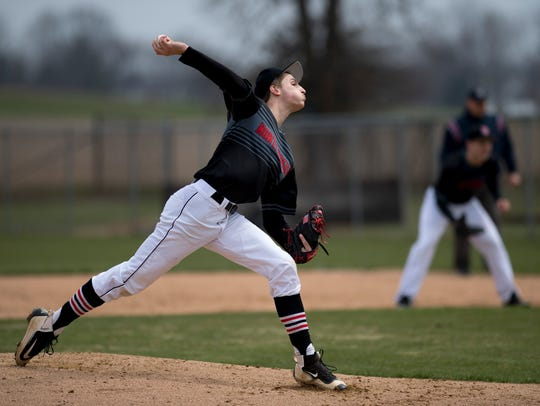 North Posey's Shane Harris (17) delivers a pitch against the Carmi Bulldogs at North Posey High School.