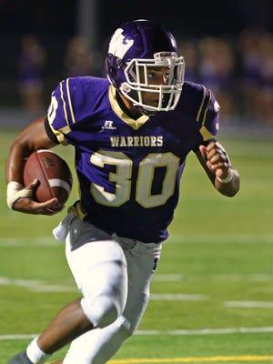 Waukee High School's Trevor Allen runs with the ball during the Johnston at Waukee High School class 4-A game at Waukee Stadium on Friday, Sept. 19, 2014.