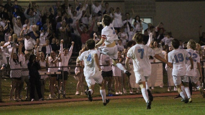 Maclay senior Daniel Sweeney leaps in the air after scoring the game-winning goal int he 67th minute to help the Marauders beat Shorecrest Prep 1-0 in a Class 1A state semifinal.