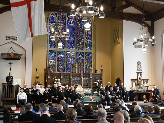 The honor guard assembles at the front of the church