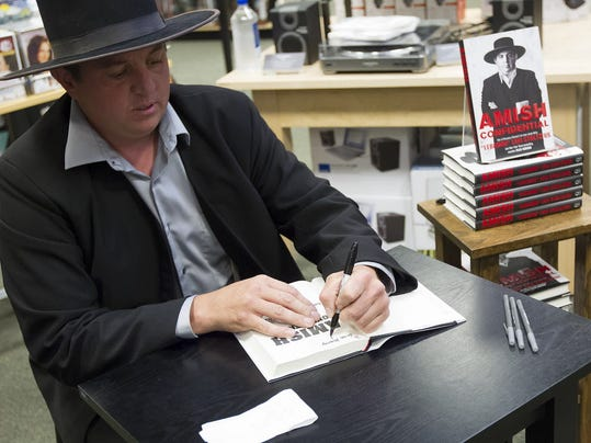 "Author and realty TV star ""Lebanon"" Levi Stoltzfus signs copies of his new book, ""Amish Confidential"", at the Barnes & Noble in Camp Hill in May."