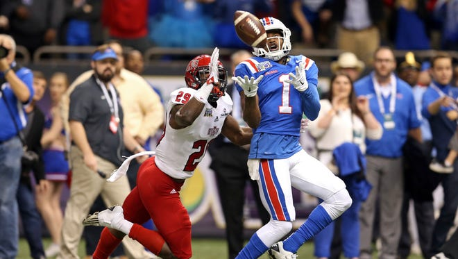 Louisiana Tech Bulldogs wide receiver Carlos Henderson (1) makes a catch while defended by Arkansas State Red Wolves defensive back Chris Humes (29) in the first quarter of the 2015 New Orleans Bowl at the Mercedes-Benz Superdome.