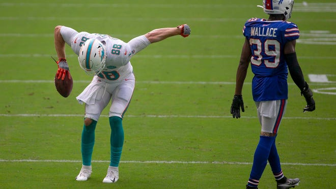 Miami tight end Mike Gesicki (88) celebrates a catch against the Bills last Sunday, specifically against cornerback Levi Wallace. Miami threw 13 passes Wallace's way and completed nine for 107 yards.