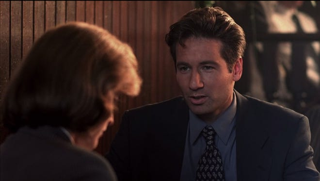 """""""The X-Files"""" stars Gillian Anderson (left) as Dana Scully, and David Duchovny as Fox Mulder."""