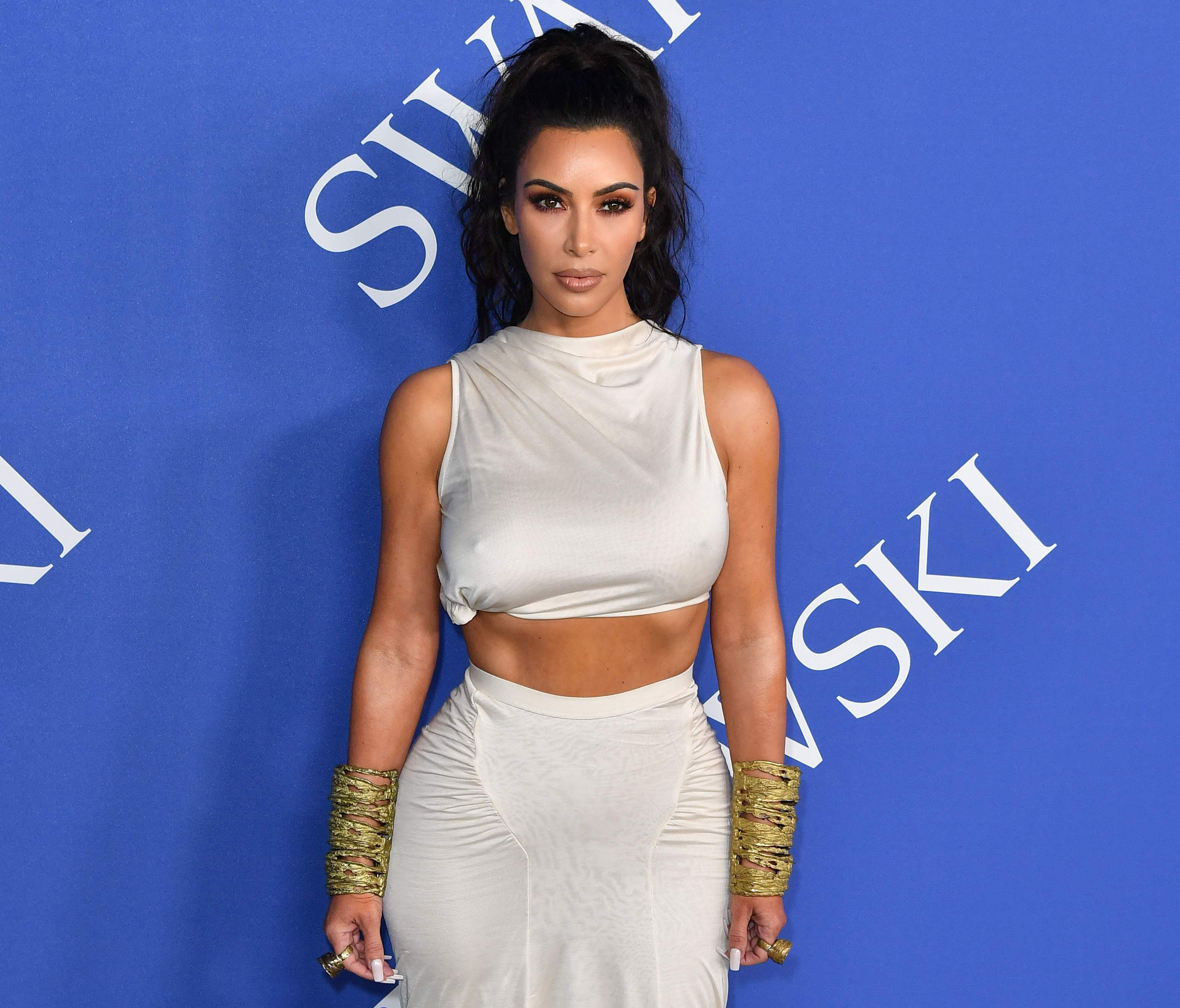 Kim Kardashian West arrived in a two-piece white ensemble for the event honoring the biggest names in fashion.