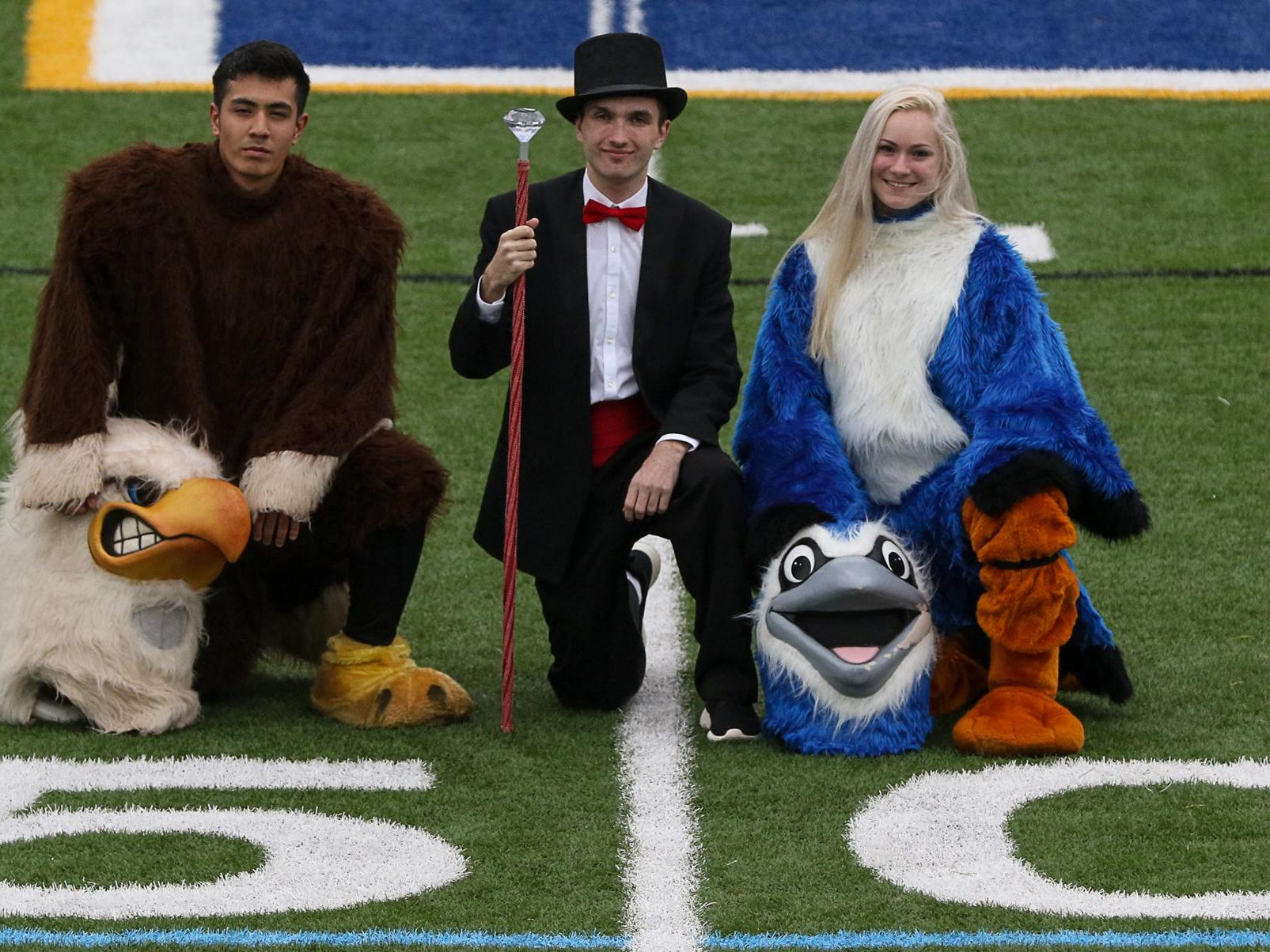 Competition transcends the football field as high school mascots from the Greater Middlesex Conference battle in the MyCentralJersey.com Snapple Bowl's inaugural Mascot Challenge. From left, Avesto Yusufiy, the Edison Eagle; Johnathon O'Halloran, the Woodbridge Barron, and Jenna Loutes, Boomer the Middlesex Blue Jay, pose in costume.