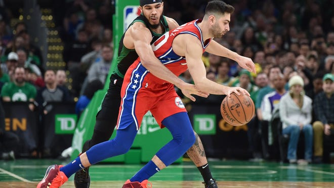 Boston Celtics forward Jayson Tatum (0) tries to steal the ball from Philadelphia 76ers guard Furkan Korkmaz (30) during the second half at TD Garden on Feb. 1, 2020.