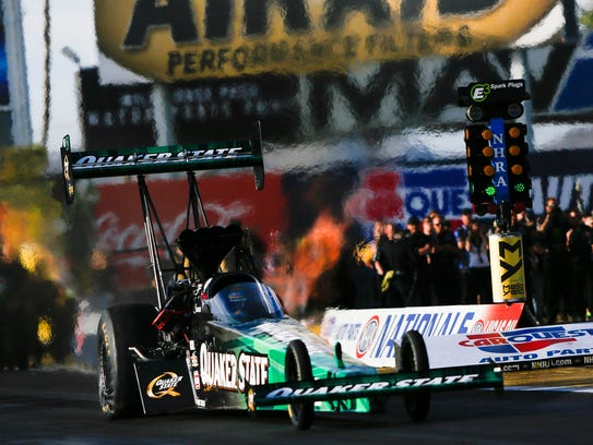 Leah Pritchett takes off during the Top Fuel finals