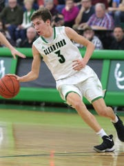 Clear Fork's AJ Blubaugh dribbles the ball down the court while playing a a home game against Ontario on Tuesday.