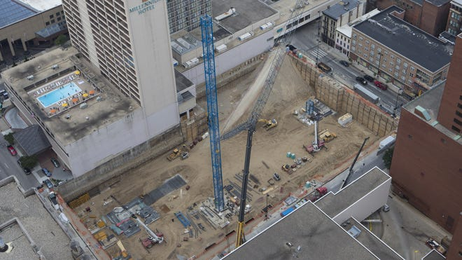 Workers seen from Carew Tower use one crane to build another at the Downtown construction site of dunnhumbyUSA's headquarters. The project is being built with the assistance of New Markets Tax Credit funds in addition to other pools of funding.