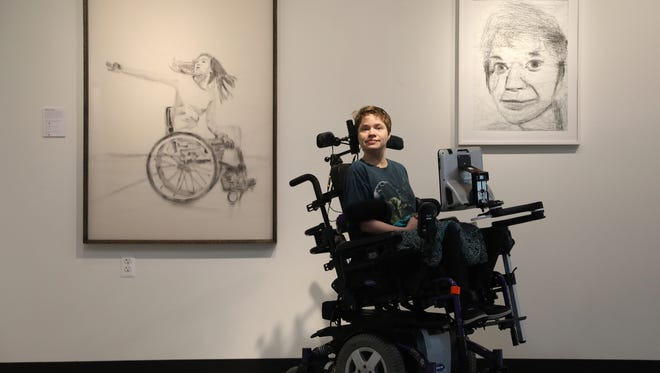 Inside the Soul Studio in West Bloomfield, Michigan on Thursday, June 7, 2018, Felicia Bowers, 27, proudly shows off two of the three drawings she did uses her Eye Gaze on her iPad Bowers who has cerebral palsy is able to use the latest technology not only to draw but also to communicate with others.